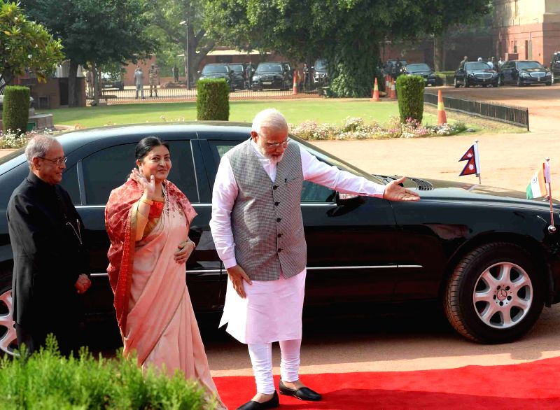 President of Nepal Bidya Devi Bhandari being received by President Pranab Mukherjee and Prime Minister Narendra Modi, at a Ceremonial Reception organised for her at Rashtrapati Bhavan, in ... - Narendra Modi and Pranab Mukherjee