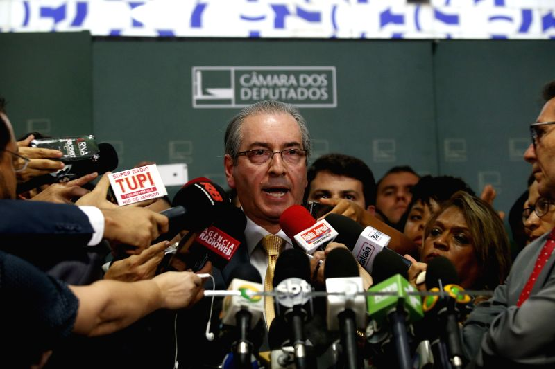 President of the Chamber of Deputies Eduardo Cunha (C) talks to the media in Brasilia, Brazil, on Dec. 2, 2015. Eduardo Cunha announced on Wednesday that he ...