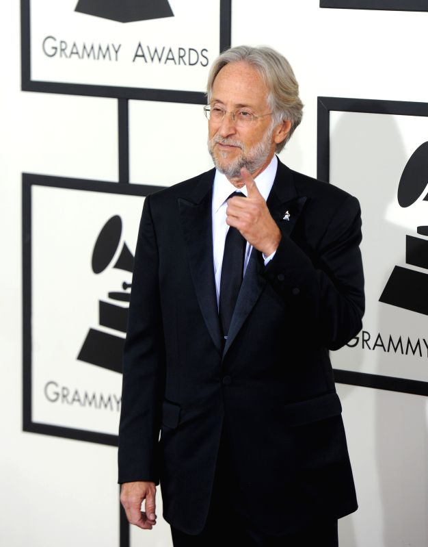 : President of the National Academy of Recording Arts and Sciences Neil Portnow arrives on the red carpet for the 56th Grammy Awards at the Staples Center in ...