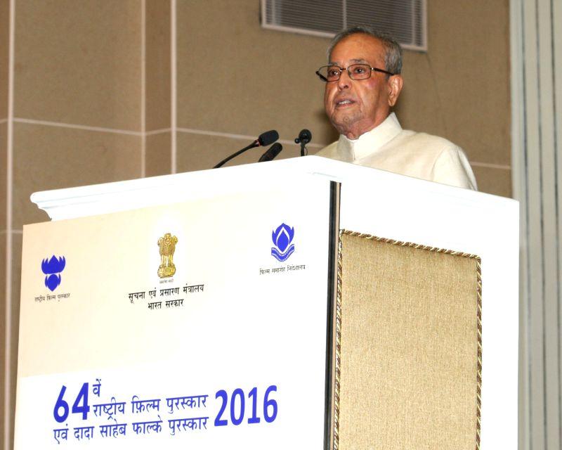 President Pranab Mukherjee addresses at the 64th National Film Awards Function in New Delhi, on May 3, 2017. - Pranab Mukherjee