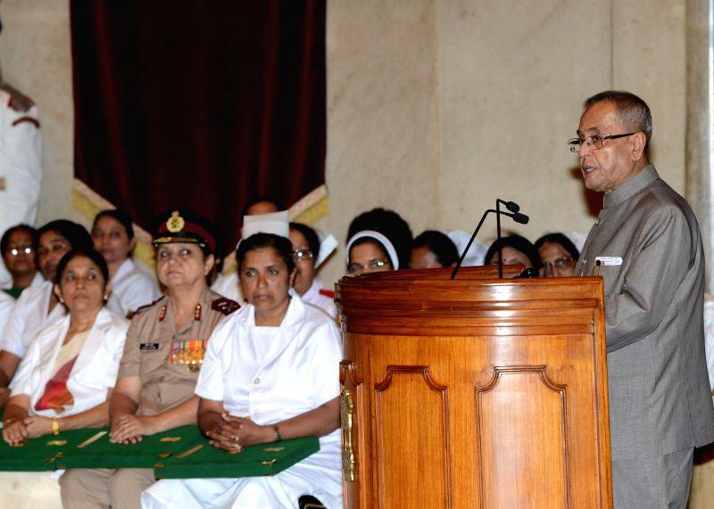 President Pranab Mukherjee addresses during National Florence Nightingale Awards to nurses at Rashtrapati Bhavan in New Delhi on May 12, 2014. - Pranab Mukherjee
