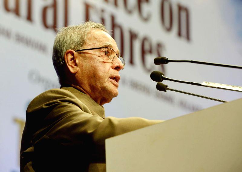 President Pranab Mukherjee addresses during inauguration of International Conference on Natural Fibres in Kolkata on August 1, 2014. - Pranab Mukherjee