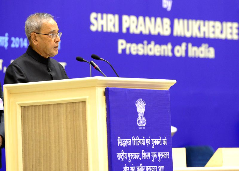 President Pranab Mukherjee addresses during a programme organised to confer National Awards, Shilp Guru Awards and Sant Kabir Awards to master craftspersons and weavers for 2011 at Vigyan Bhavan in .. - Pranab Mukherjee