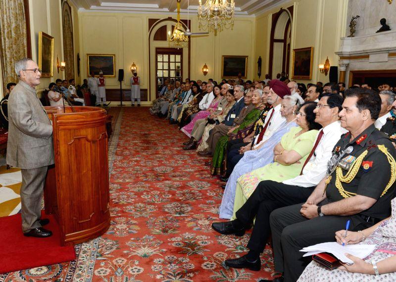 President Pranab Mukherjee addresses former AsDC (aides-de-camp) to the President of India during a reunion of AsDC at Rashtrapati Bhavan in New Delhi on May 4, 2014. - Pranab Mukherjee