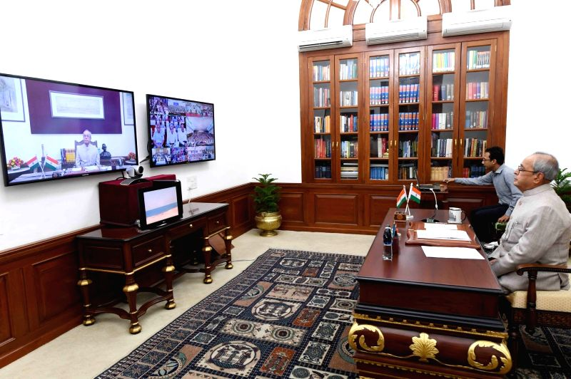 President Pranab Mukherjee addresses to the students/faculty of higher academic institutions and officer trainees at civil service academies through video conference using National ... - Pranab Mukherjee