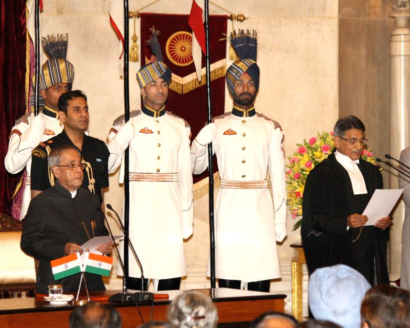 President Pranab Mukherjee administering oath to Justice Rajendra Mal Lodha to the office of Chief Justice of India at Rashtrapati Bhawan in New Delhi on Apr. 27. - Pranab Mukherjee