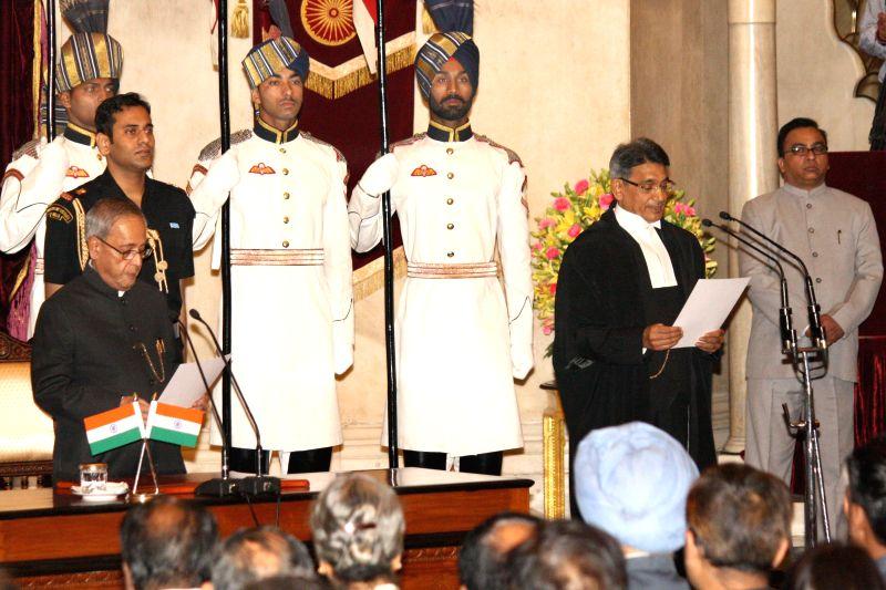 President Pranab Mukherjee administering oath to Justice Rajendra Mal Lodha to the office of Chief Justice of India at Rashtrapati Bhawan in New Delhi on Apr. 27. - Pranab Mukherjee