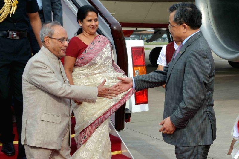 President Pranab Mukherjee  and his daughter Sharmistha Mukherjee being welcomed on their arrival in Beijing on May 25, 2016. - Pranab Mukherjee and Sharmistha Mukherjee