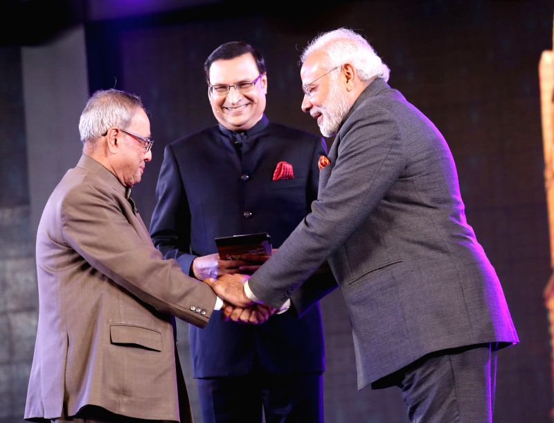 President Pranab Mukherjee and Prime Minister of India Narendra Modi with Rajat Sharma, Chairman and Editor in Chief of India TV during Aap Ki Adalat's 21st anniversary celebrations in New Delhi on .. - Narendra Modi, Pranab Mukherjee and Rajat Sharma