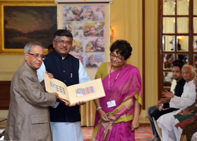 President Pranab Mukherjee and Union Minister for Communications and Information Technology, and Law and Justice, Ravi Shankar Prasad during a programme to release a set of eight commemorative ... - Pranab Mukherjee