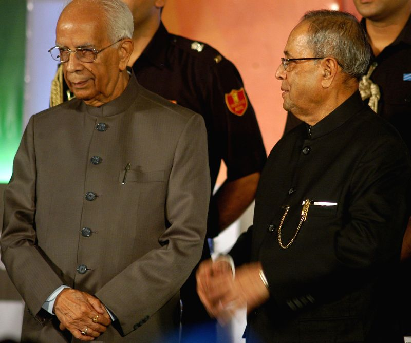 President Pranab Mukherjee and West Bengal Governor Keshari Nath Tripathi during 86th Annual General Meeting of Indian Chamber of Commerce in Kolkata on August 1, 2014. - Pranab Mukherjee and Keshari Nath Tripathi