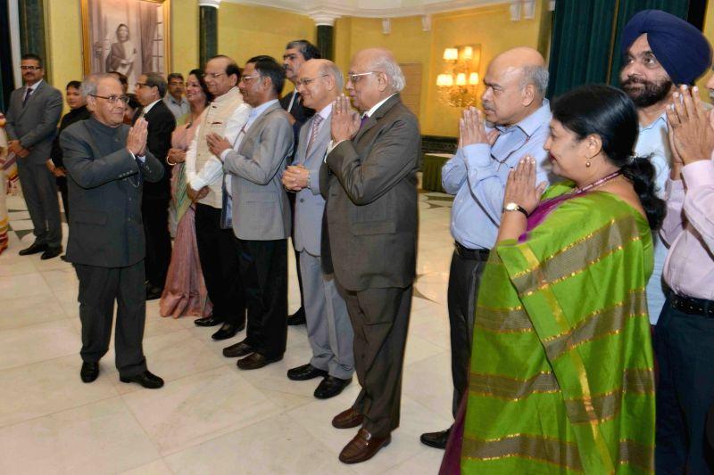 President Pranab Mukherjee attends the reception on the occasion of Civil Services Day at Rashtrapati Bhavan Cultural Centre (RBCC) in New Delhi, on April 21, 2017. - Pranab Mukherjee