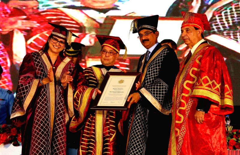 President Pranab Mukherjee being conferred the Doctorate Honoris Causa Degree by the Chancellor of LPU Amit Mittal at the 8th Convocation of Lovely Professional University in Phagwara, ... - Pranab Mukherjee