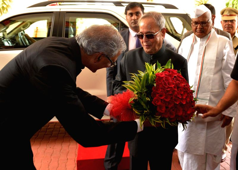 President Pranab Mukherjee being greeted as he arrives to attend the golden jubilee convocation of Jawaharlal Nehru Krishi Vishwa-vidyalaya at Jabalpur in Madhya Pradesh on June 27, 2014. - Pranab Mukherjee