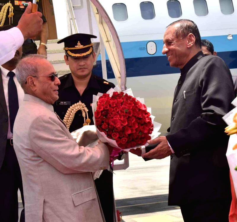 President Pranab Mukherjee being received by Telangana Governor ESL Narasimhan at Begumpet Airport in Hyderabad on April 26, 2017. - Pranab Mukherjee