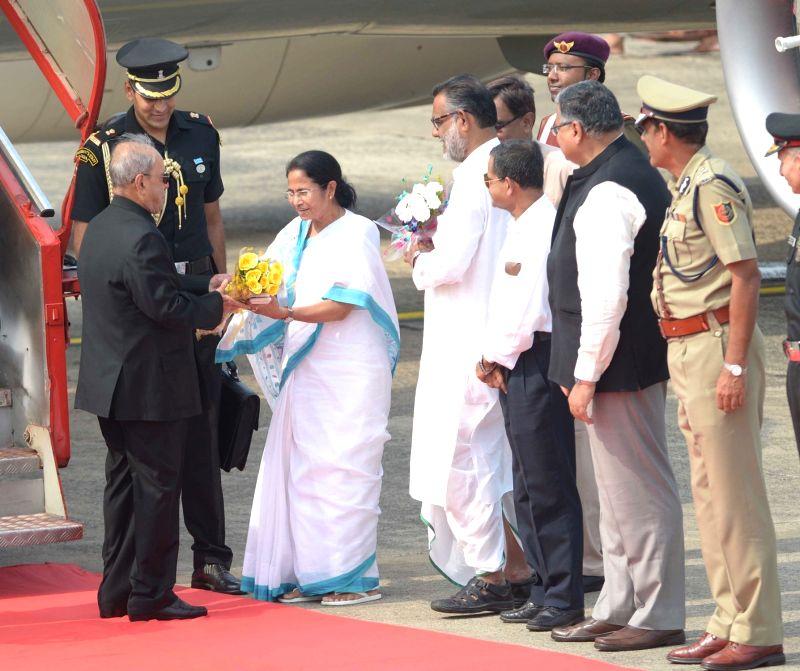 President Pranab Mukherjee being received by West Bengal Chief Minister Mamata Banerjee at Netaji Subhas Chandra Bose International Airport in Kolkata on May 18, 2017. - Mamata Banerjee and Pranab Mukherjee