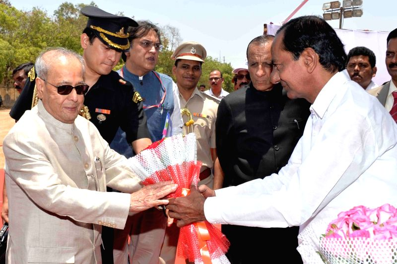 President Pranab Mukherjee being welcomed by Telangana Chief Minister K Chandrasekhar Rao during the inauguration of Osmania University's centenary celebrations in Hyderabad on April 26, ... - K Chandrasekhar Rao and Pranab Mukherjee