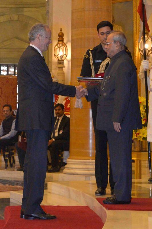 President Pranab Mukherjee conferred the first `Distinguished Indologist` Award to Prof. Emeritus Heinrich Freiherr Von Stietencron of the Federal Republic of Germany during the ... - Pranab Mukherjee