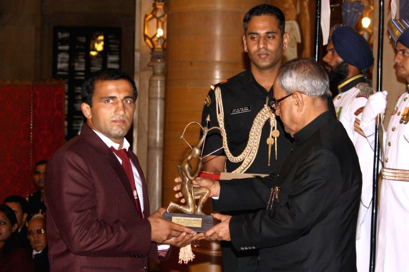 President Pranab Mukherjee confers Arjuna Award to Sunil Kumar Rana during a programme organised at Rashtrapati Bhavan, in New Delhi on August 29, 2014. - Pranab Mukherjee and Sunil Kumar Rana