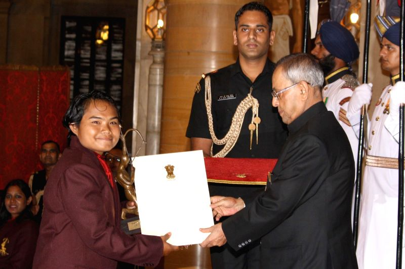 President Pranab Mukherjee confers Arjuna Award to Yumanam Renu Bala Chanu during a programme organised at Rashtrapati Bhavan, in New Delhi on August 29, 2014. - Pranab Mukherjee