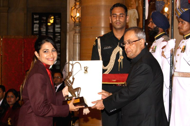 President Pranab Mukherjee confers Arjuna Award to Heena Sidhu during a programme organised at Rashtrapati Bhavan, in New Delhi on August 29, 2014. - Pranab Mukherjee