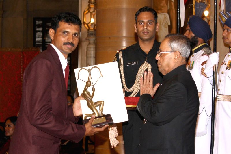 President Pranab Mukherjee confers Arjuna Award to Saji Thomus during a programme organised at Rashtrapati Bhavan, in New Delhi on August 29, 2014. - Pranab Mukherjee