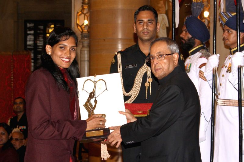 President Pranab Mukherjee confers Arjuna Award to Mamtha Poojari during a programme organised at Rashtrapati Bhavan, in New Delhi on August 29, 2014. - Pranab Mukherjee