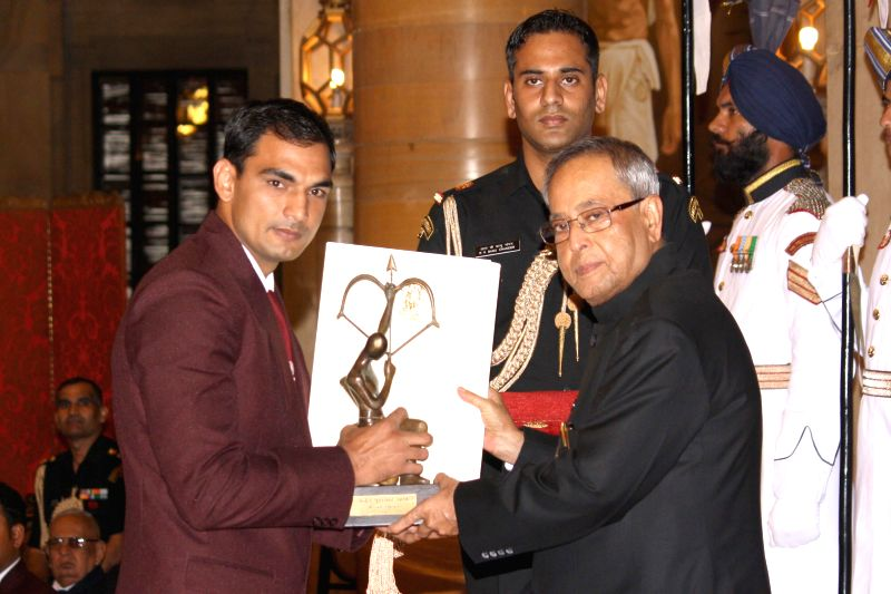 President Pranab Mukherjee confers Arjuna Award to Jai Bhagwan during a programme organised at Rashtrapati Bhavan, in New Delhi on August 29, 2014. - Pranab Mukherjee