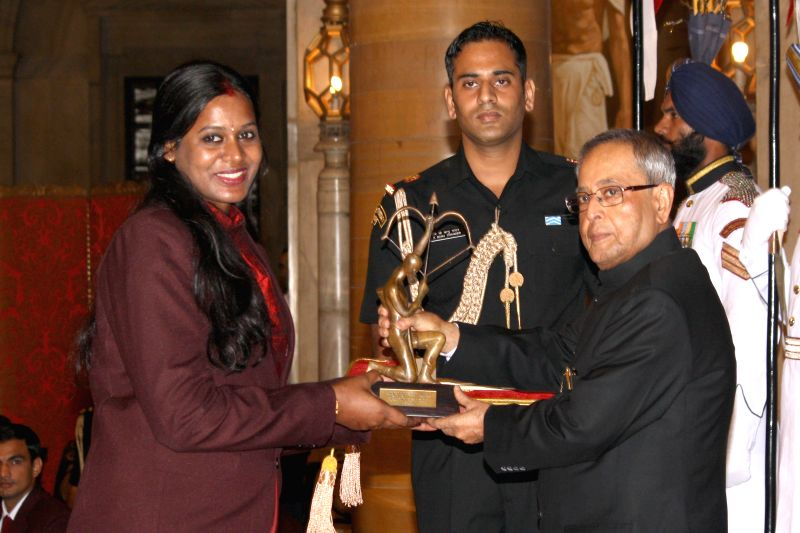 President Pranab Mukherjee confers Arjuna Award to Geethu Anna Rahul during a programme organised at Rashtrapati Bhavan, in New Delhi on August 29, 2014. - Pranab Mukherjee and Geethu Anna Rahul