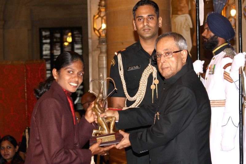 President Pranab Mukherjee confers Arjuna Award to Tintu Luka during a programme organised at Rashtrapati Bhavan, in New Delhi on August 29, 2014. - Pranab Mukherjee