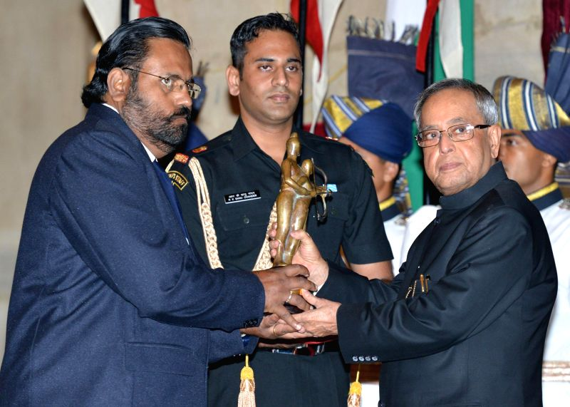 President Pranab Mukherjee confers the Dronacharya Award for the year-2014 to Jose Jacob for Rowing, auring a programme organised at Rashtrapati Bhavan, in New Delhi on August 29, 2014. - Pranab Mukherjee
