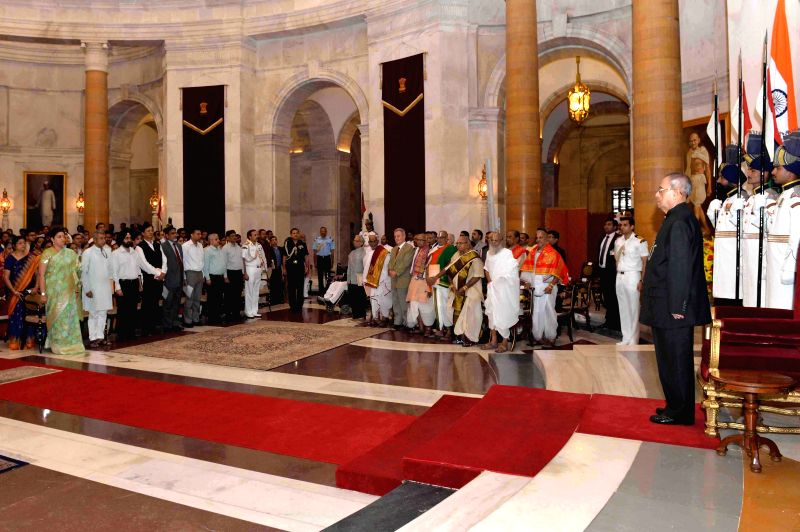 President Pranab Mukherjee during a ceremony organised to felicitate Sanskrit, Arabic, Persian and Pali/Prakrit scholars  and to present the Maharshi Badrayan Vyas Samman for the year 2014 at ... - Pranab Mukherjee