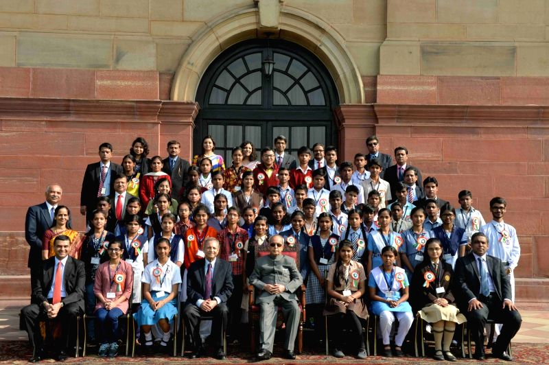 President Pranab Mukherjee, during a group photograph with the  Winners of the 2012-13 and 2013-14 Nationwide 'Tata Building India School Essay Competition at Rashtrapati Bhavan in New ... - Pranab Mukherjee