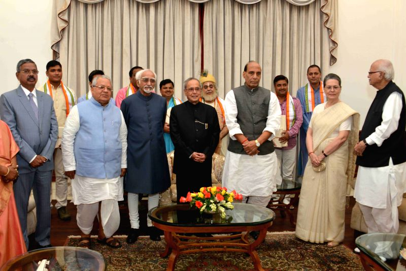 President Pranab Mukherjee during a mono act on `Kabir` by Shri Shekhar Sen at Auditorium RBCC in New Delhi on July 25, 2015. Also seen the Vice President Mohd. Hamid Ansari, the Union ... - Rajnath, Pranab Mukherjee, Kalraj Mishra, L K Advani and Sonia Gandhi