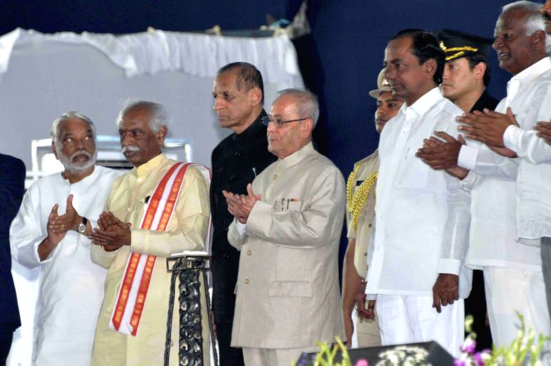 President Pranab Mukherjee during inauguration of Osmania University's centenary celebrations in Hyderabad on April 26, 2017. Also seen Telangana Governor ESL Narasimhan, Chief Minister K ... - K Chandrasekhar Rao and Pranab Mukherjee