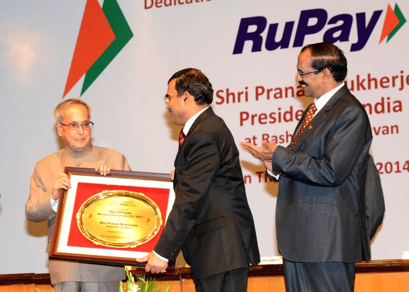 President Pranab Mukherjee during launch of RuPay card - an indigenous payment card developed by National Payments Corporation of India (NPCI), a not-for-profit company envisioned by the Reserve Bank - Pranab Mukherjee