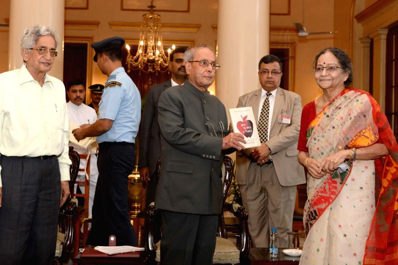 "President Pranab Mukherjee during presentation of books ""Jnan, A-Jnan O Bijnan"" (Knowledge, Non-Knowledge and Science) and ""Samudra Banijjer Prekshite Sthala Banijjya, Bharat ... - Pranab Mukherjee"