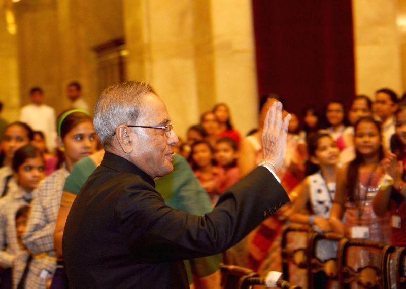 President Pranab Mukherjee during Raksha Bandhan celebrations at Rashtrapati Bhawan in New Delhi on Aug 10, 2014. - Pranab Mukherjee