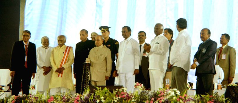 President Pranab Mukherjee during the inauguration of Osmania University's centenary celebrations in Hyderabad on April 26, 2017. Also seen Telangana Governor ESL Narasimhan, Chief ... - K Chandrasekhar Rao and Pranab Mukherjee