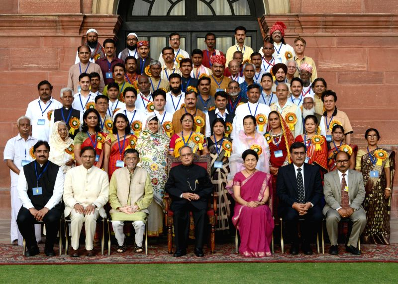 President Pranab Mukherjee in a group photo with recipients of National Awards, Shilp Guru Awards and Sant Kabir Awards at Rashtrapati Bhavan in New Delhi on July 1, 2014.