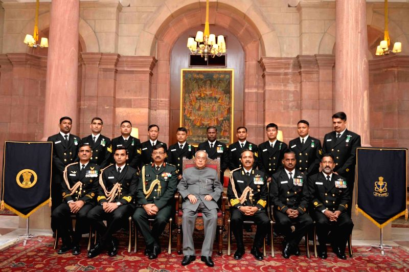 President Pranab Mukherjee in a group  with the Naval Contingent attached with Rashtrapati Bhavan on Navy Day in New Delhi, on Dec 4, 2015. - Pranab Mukherjee