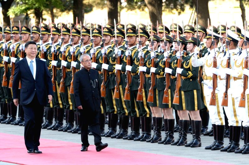 President Pranab Mukherjee inspects the guard of honour during the welcome ceremony in Beijing, China on May 26, 2016. Also seen President of the People's Republic of China Xi Jinping. - Pranab Mukherjee