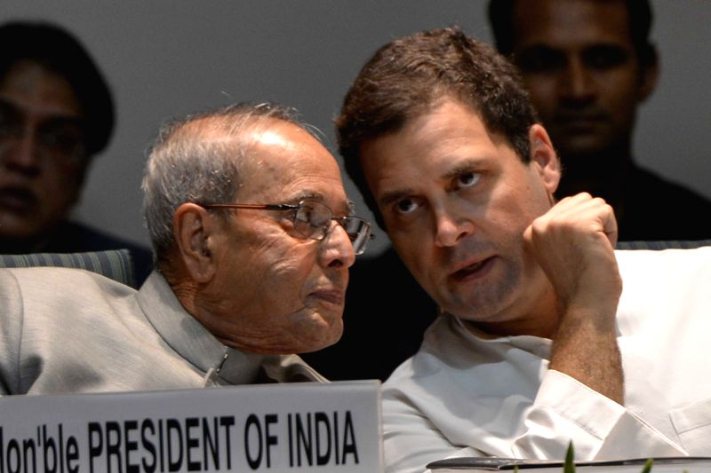 "President Pranab Mukherjee interacts with Congress vice-president Rahul Gandhi during the launch of a commemorative volume of the book ""India's Indira : A Centennial Tribute"" ... - Pranab Mukherjee and Rahul Gandhi"