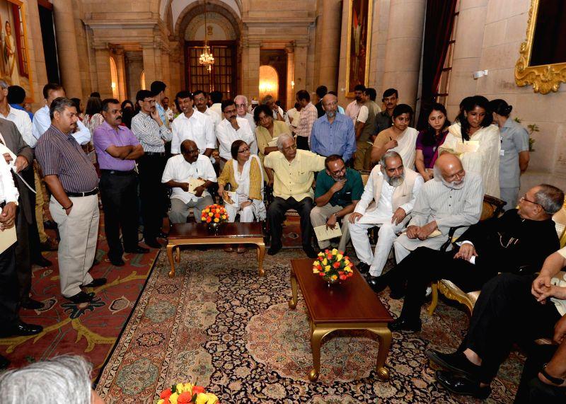President Pranab Mukherjee interacts with media persons at Rashtrapati Bhawan in New Delhi on July 30, 2014.