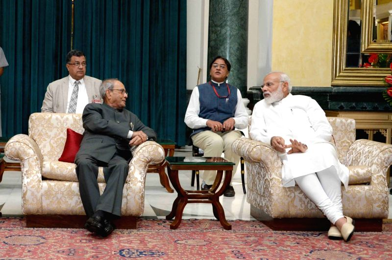 President Pranab Mukherjee interacts with Prime Minister Narendra Modi during the reception on the occasion of Civil Services Day at Rashtrapati Bhavan Cultural Centre (RBCC) in New Delhi, ... - Narendra Modi and Pranab Mukherjee