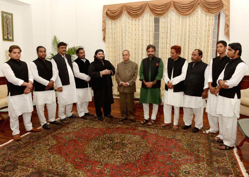 President Pranab Mukherjee interacts with Ustad Chand Afzal and others after `Sufiana Qawali` at Rashtrapati Bhawan Auditorium in New Delhi on July 28, 2014. - Pranab Mukherjee