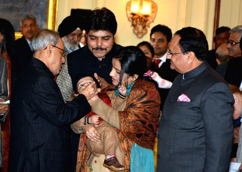 President Pranab Mukherjee launchs the Nationwide Polio Programme by administering Polio Drops to the Children, at Rashtrapati Bhavan, in New Delhi on Jan 16, 2016. Also seen the Union ... - Pranab Mukherjee