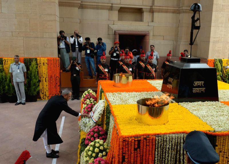 President Pranab Mukherjee lays wreath at Amar Jawan Jyoti, India Gate on 68th Independence Day in New Delhi on Aug 15, 2014. - Pranab Mukherjee