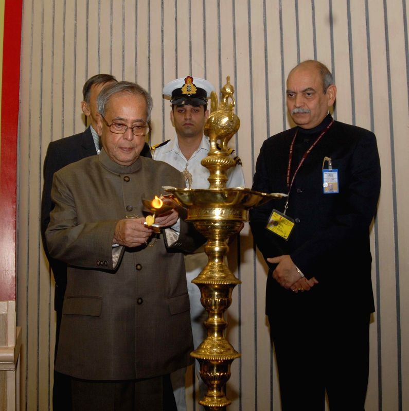 President Pranab Mukherjee lights the inaugural lamp during a programme organised on  'Enforcement Day' to celebrate Foundation Day of the Enforcement Directorate at Vigyan Bhavan in New Delhi on May - Pranab Mukherjee