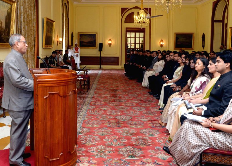 President Pranab Mukherjee meeting 53 Officer Trainees of Indian Information Service (IIC) from Indian Institute of Mass Commmunication at Rashtrapati Bhavan in New Delhi on April 12, 2014.